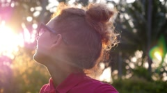 Closeup Of Smiling Beautiful Young Woman In Summer Holiday at Sunset Stock Footage
