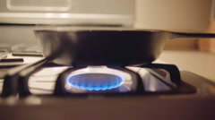 Low angle view of frying pan on gas stove 4K Stock Footage