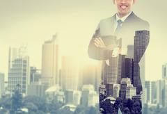 Stock Photo of business man double exposure concept in the city
