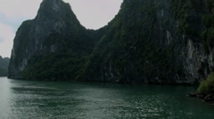 A boat cruise through Ha Long Bay Vietnam  - Clip X3 Stock Footage