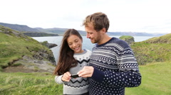 Couple on using smartphone app on Iceland Stock Footage