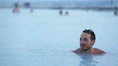 Geothermal spa - man relaxing in hot spring pool Stock Footage