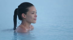 Hot spring pool - woman relaxing in geothermal spa on Iceland Stock Footage
