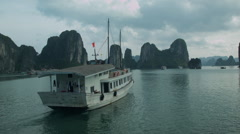 A boat cruise through Ha Long Bay Vietnam  - Clip X6 Stock Footage