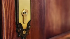 The man opens the door using the key Stock Footage