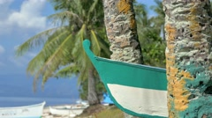Tropical beach with boat and palm trees - stock footage