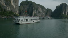 A boat cruise through Ha Long Bay Vietnam  - Clip X7 Stock Footage