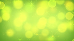 green bokeh lights and fairy dust loopable background - stock footage