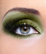 Make-up of woman eye with khaki eyeshadows Stock Photos