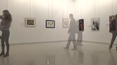 Customers Visiting The Paintings At The Gallery Timelapse Stock Footage
