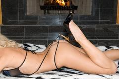 High Heels by the Fire Stock Photos