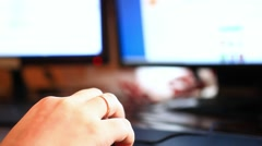 Human hand on computer mouse. Monitors On desk. HD. 1920x1080 Stock Footage