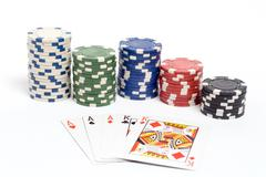 Full house poker hand with colored poker chips. - stock photo