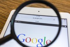 CHIANG MAI, THAILAND - SEPTEMBER 17, 2014: Magnifying glass of Google search  Kuvituskuvat