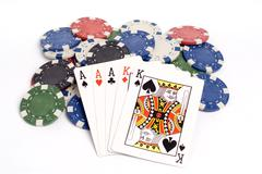 Full house poker hand with colored poker chips. Stock Photos