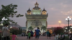 Patuxai in the evening with tourists Stock Footage