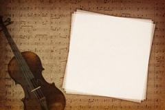 Music notes on fabric texture background with copy-space - stock photo