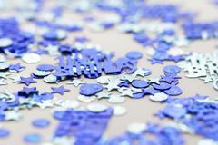Blue happy birthday confetti pieces - macro photo - stock photo