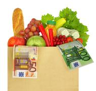 Paper bag filled with groceries and banknotes - stock photo