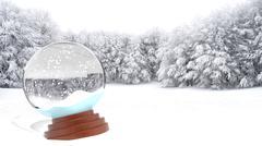 Christmas snow globe on snowy field - stock photo