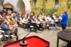 Female speaker at Business Conference. - stock photo