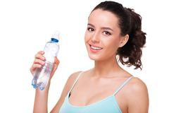 Close up of sporty woman with a bottle Stock Photos