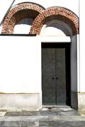 caiello  abstract   rusty   door curch  closed  italy  lombardy - stock photo