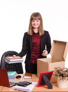 New employee in the office arranges personal belongings - stock photo