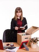 Dismissed girl puts personal belongings in office - stock photo