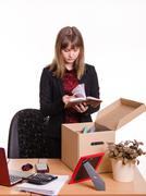Dismissed girl in office goes through personal belongings - stock photo