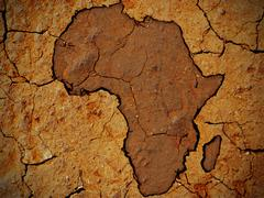 Africa shape on dry soil - stock illustration