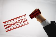 Classify a Confidential file with a red stamp Stock Illustration