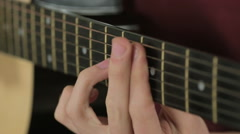 Close-up of strings on a guitar while playing Stock Footage