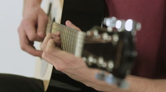 Close-up of a guitarist playing in the studio Stock Footage