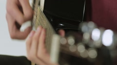 Close-up of a guitar while playing Stock Footage