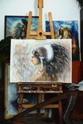 Indian woman in painting atelier on stand with harp and painting Stock Photos