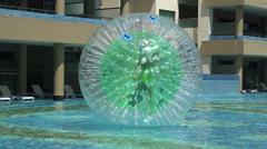 Pool Human Hamster Ball Playing - Closeup Follow Movement Stock Footage