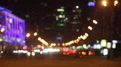 Out of focus city traffic at night. Car headlights and tail lights out of focus. Stock Footage