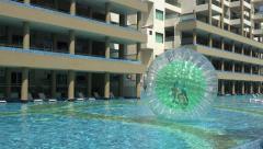 Pool Human Hamster Ball Playing - Medium Pan Stock Footage