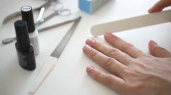 Female hands doing manicure, sawing nails nail file. HD. 1920x1080 Stock Footage