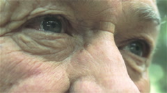 Sad old man portrait: closeup portrait on eyes of a old man Stock Footage