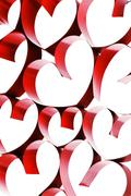 Linked ribbon hearts - stock photo