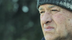 Pensive old man deep in his thoughts: sad, sadness, loneliness  Stock Footage