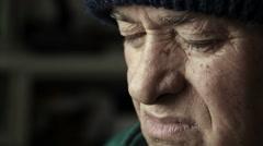 Sad old man: closeup footage on very old man: thoughtful elderly man, sad eyes  Stock Footage