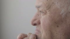thoughtful elderly man sitting pensive and depressed  - stock footage