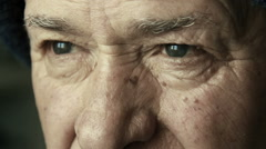 old man face: closeup portrait of old man eyes, elderly man gaze - stock footage