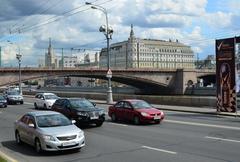 Machines are moving along the Kremlin embankment - stock photo
