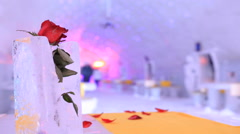 Rose in ice inside an ice hotel - time lapse scene Stock Footage