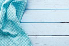 Checkered napkin on blue table Stock Photos