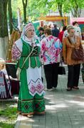 Gomel, Belarus, outdoor events City Wizards. Woman in Belorusian suit Stock Photos